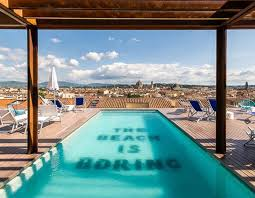 View of rooftop pool and Florence city skyline
