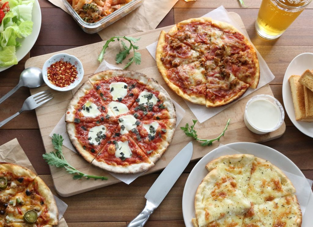 Flat-lay of pizzas ready to eat